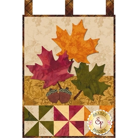 Red, yellow, and green maple leaf appliques with a pair of acorns.