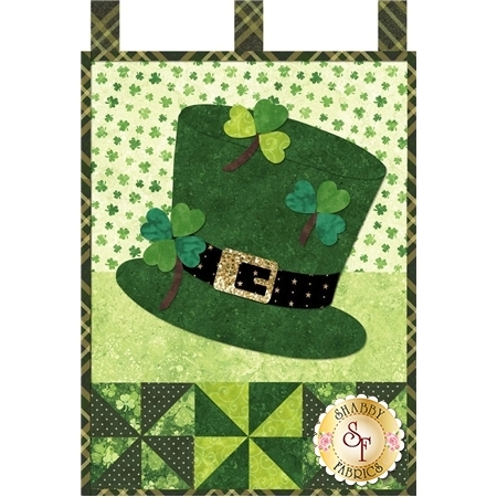 Green top hat with black belt and sparkly gold buckle. It's decorated with three green shamrocks.