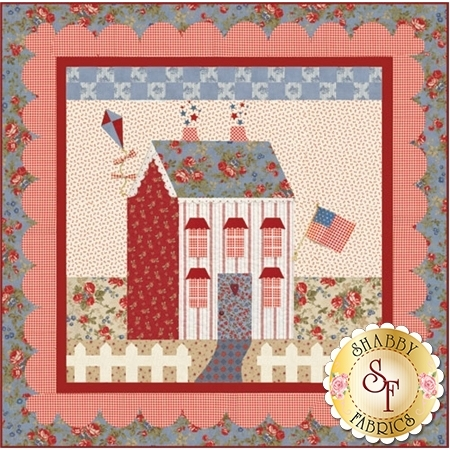 Red and cream cottage house with patriotic flag.