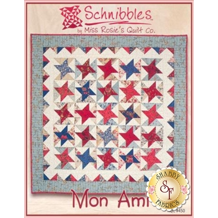 Patchwork quilt pattern featuring red and blue friendship star blocks.