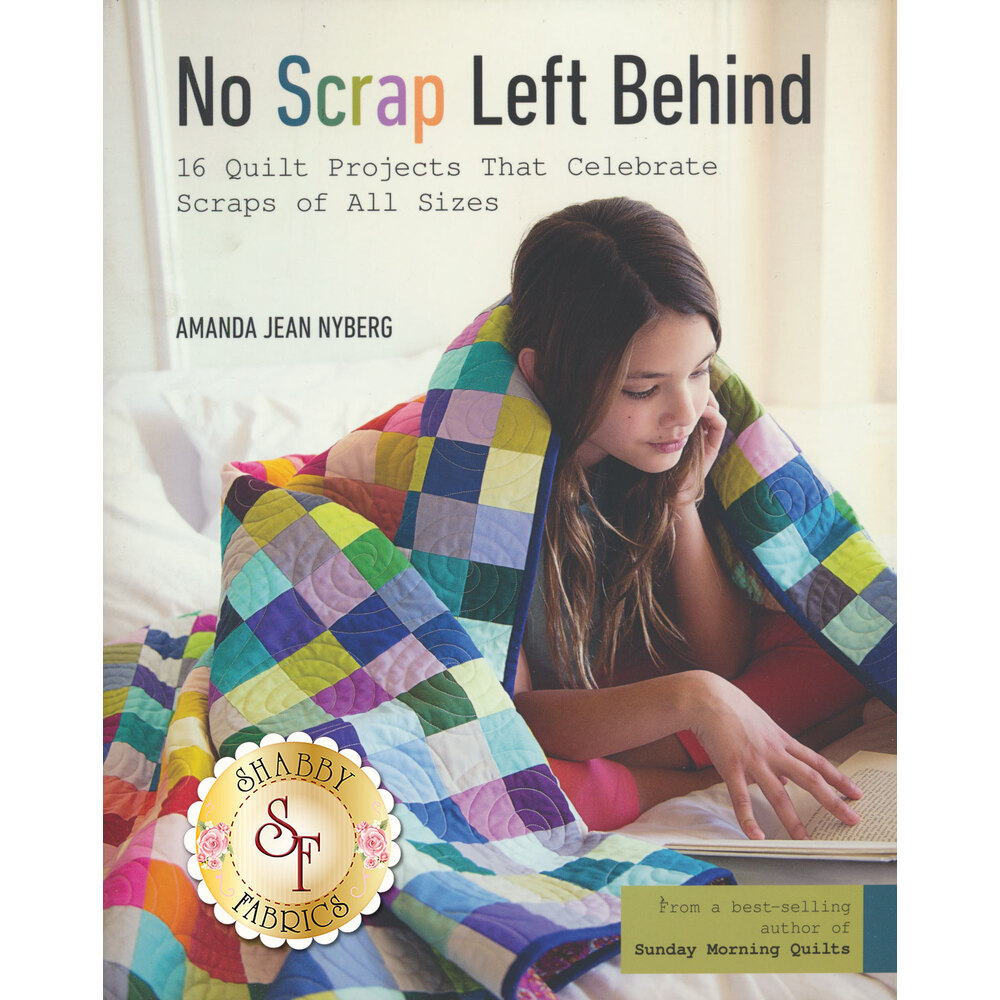 The front of the No Scrap Left Behind book featuring a completed quilt