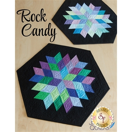 Geometric star shape made of patchwork diamonds in blue, purple, and green.