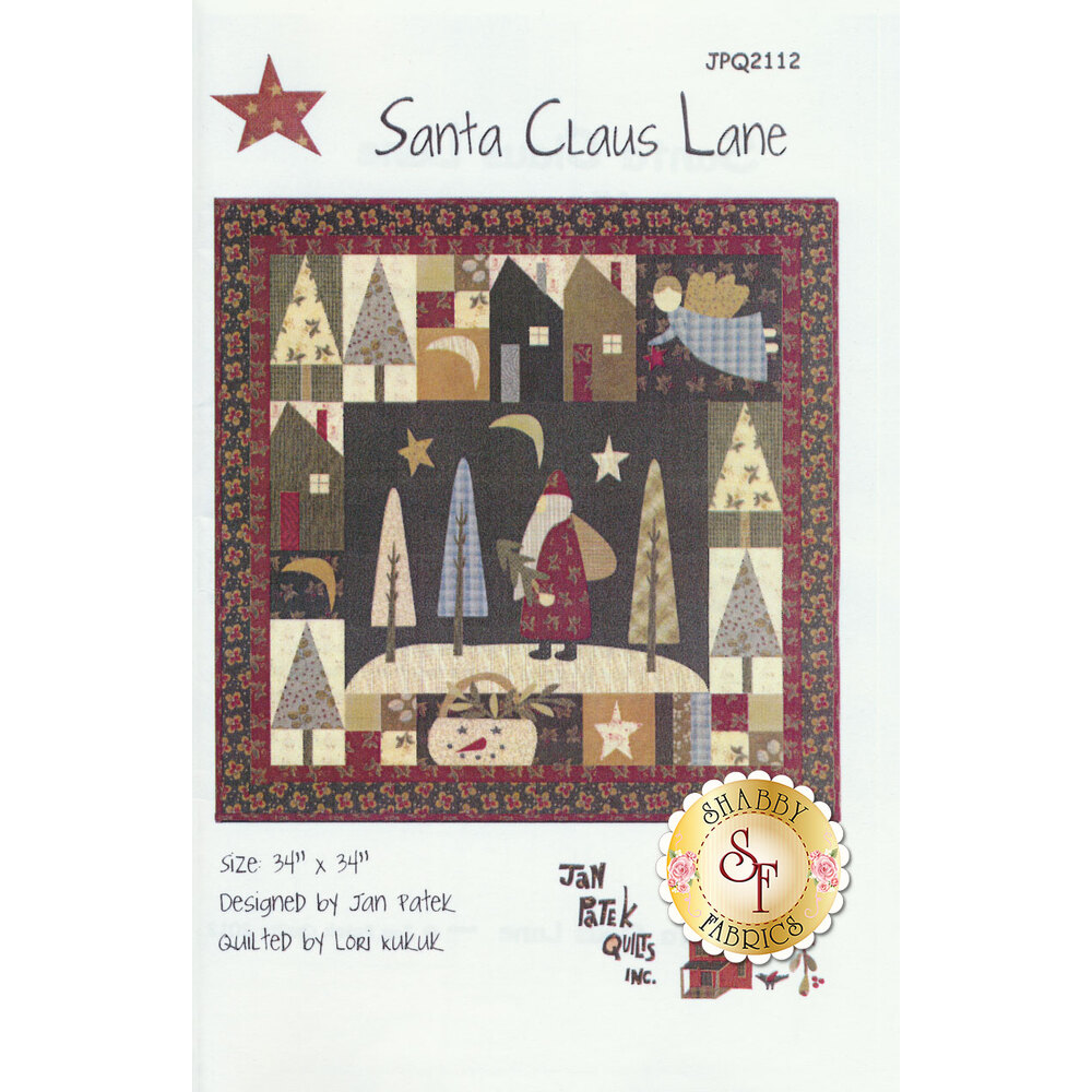 The front of the Santa Claus Lane pattern showing the finished Christmas wall hanging