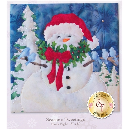 Overjoyed snowman in a red Santa hat wearing a Christmas wreath with birds roosting on his arms.