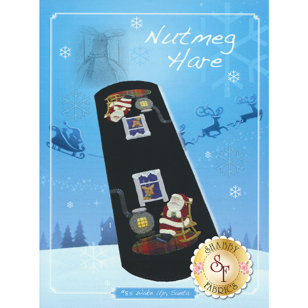 The cover of Wake Up, Santa Pattern featuring Santa Claus by a wood stove | Shabby Fabrics