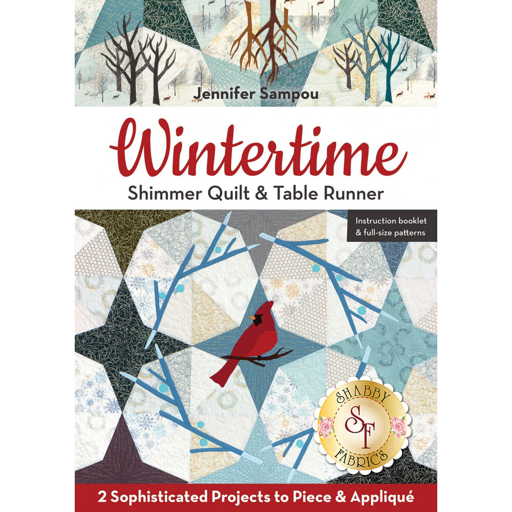 The front of the Wintertime Shimmer Quilt & Table Runner packet showing the design of the quilt