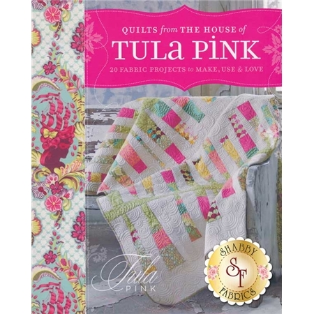 Cover of The House of Tula Pink Book featuring a brightly colored patchwork quilt over a grey bench.