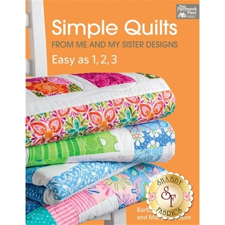 book of simple quilts with orange cover and bright patchwork quilts