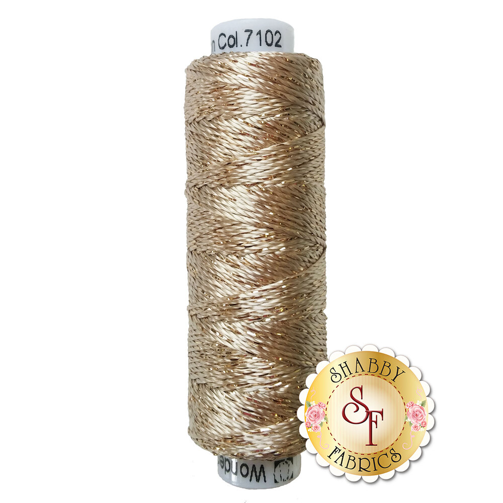 Tan metallic thread on a white spool | Shabby Fabrics