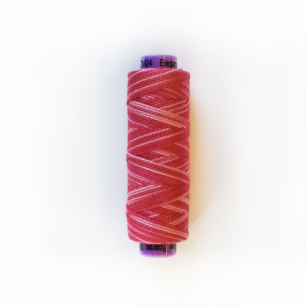 Red and light pink embroidery thread on a purple spool | Shabby Fabrics