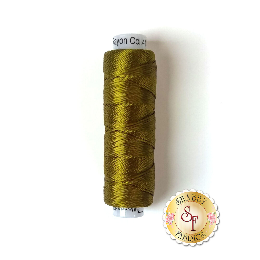 A spool of beautiful olive green thread - Razzle 4122 Ecru Olive