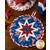 The coordinating white and blue America the Beautiful Folded Star Hot Pad on a wood table