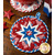 The red and white version of the Folded Star Hot Pad - America the Beautiful on a wood table