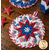 The white and blue coordinating America the Beautiful Folded Star Hot Pads on a wood table