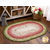 A beautiful Jelly Roll Rug displayed on a wood floor