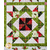 One block of the Poinsettia & Pine Patchwork Quilt | Shabby Fabrics
