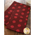 Red towels with tonal polka dots displayed on table | Shabby Fabrics