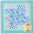 blue and floral quilt with patchwork pinwheels
